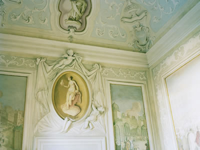 Villa Cornaro interior wall sculpture above doorway brighter lighting.