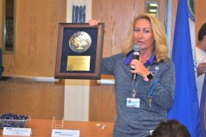 Mrs. Wier with the Blue Bell Award Plaque for FSWC's Blue Ribbon Recognition
